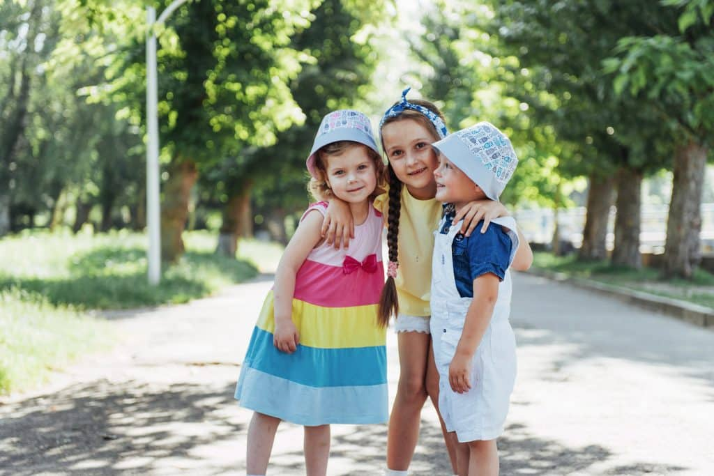 lovely cute kids playing in the park a beautiful s H5A4A2E